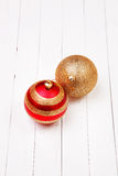Christmass balls on a white background. Christmass balls on a white wooden background stock images