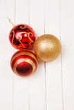 Christmass balls on a white background. Christmass balls on white wooden background royalty free stock images