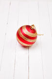 Christmass balls on a white wooden background Stock Image