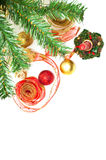 Christmass decorations next to a christmass tree Royalty Free Stock Photography