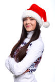 Christmass girl. Smiling young woman in red christmass hat at white background Stock Image