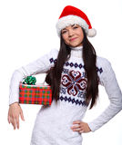 Christmass girl. Smiling young woman in red christmass hat at white background with gifts Stock Photo