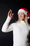 Christmass girl smiling and looking at here toy. Christmass girl holding beatuful christmass toy Stock Image
