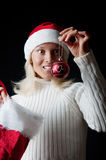 Christmass girl smiling and looking at here toy Stock Photos