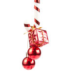 Christmass ornaments hanging on candy cane Royalty Free Stock Image