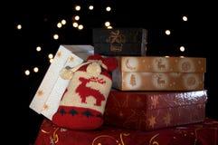 Christmass presents. Stacked Christmas gifts on a dark christmas scene Stock Image