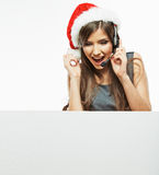 Christmass Santa woman hold white sign blank board. Young model isolated Royalty Free Stock Photography