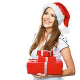 Christmass style portrait of smiling young woman isolated on wh. Ite background with gift box Royalty Free Stock Photo