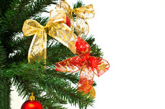Christmass tree branches with balls and ribbons Stock Images