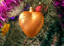 Christmass-tree decoration 4. Orange heart stock photo