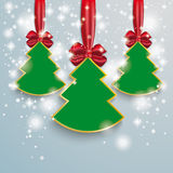 3 Christmass Tree Snow Lights Red Ribbon. Snow with stars, christmas tree and red ribbon on the grey background Royalty Free Stock Photography