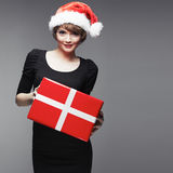 Christmass woman hold gift. Beautiful fashion model Stock Photo