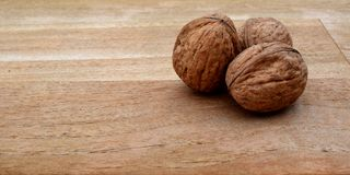 Christmassy background with Walnuts on wodden planks.  Stock Photos