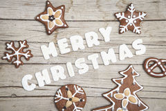 Christmassy grey wood background with gingerbread and Merry Christma`s letter Royalty Free Stock Photo