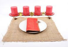 Christmassy table setting with burlap and candles Stock Images