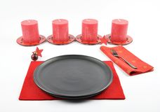 Christmassy table setting with felt and candles Stock Image