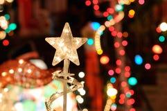 Christmast lampor och stjärna Arkivfoton