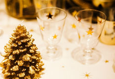 Christmastime table setting with golden festive decorations Stock Image