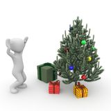 Christmastree. A character is happy about the gifts under the tree Royalty Free Stock Images
