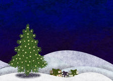 Christmastree and gifts. In snowy landscape Stock Image