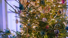 Christmastree glows inside village house stock video footage