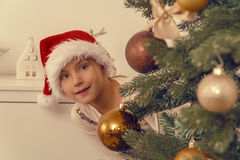 Christmastree ornamate. Helping hands from child beautifying tree Stock Photography