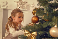 Christmastree ornamate. Helping hands from child beautifying tree Royalty Free Stock Images