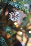 Christmastree swarovski crystal snowflake. Ornament celebrate holiday bokeh lights winter Royalty Free Stock Image