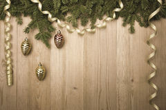 ChristmasVintage Background with fir tree, golden ribbon and dec Royalty Free Stock Photo
