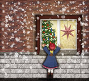The christmaswindow. Little girl looking through the window at the christmastree Stock Photography