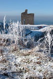 Christmasy view of ballybunion castle ruin and sea. A seasonal snow covered view of atlantic ocean and ballybunion castle on a frosty snow covered winters day Stock Images