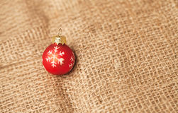Christmus bauble on burlap background Stock Photos