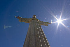 Christo rei statue with sun flare Royalty Free Stock Photos