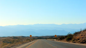 Christopher Columbus Transcontinental Highway. Downhill turn on Interstate 10 in Chiriaco mountains summit, CA Stock Photo