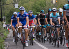 Christopher Froome riding with pack and Canada's Dominique Rolli Stock Photos