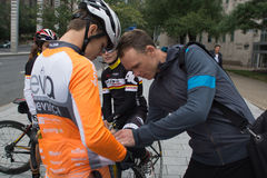 Christopher Froome signing shirt on arriving in Montreal for sec Stock Photo