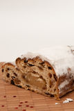 Christstollen 3. Stollens cut on little board Royalty Free Stock Image
