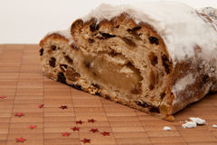 Christstollen 8. Stollens cut on little board Royalty Free Stock Photo