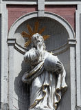 Christus Salvator. Christ on the Facade of Neumüunster Collegiate Church in Wurzburg Stock Images