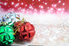 Chritmas balls on glitters background Royalty Free Stock Photography
