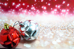 Chritmas balls on glitters with bokeh background Stock Images