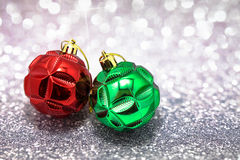 Chritmas balls on glitters with bokeh background Stock Photo