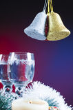Chritmas bells and glasses Royalty Free Stock Photos