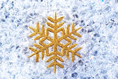 Chritmas golden snowflake symbol on ice Stock Photo