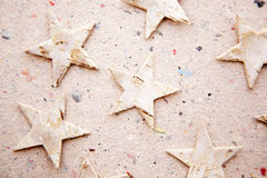 Chritmas stars on recycled paper background Royalty Free Stock Photography