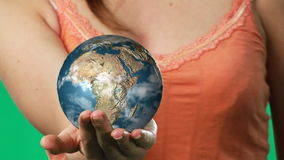 Chroma key footage of a woman holding a globe Stock Images