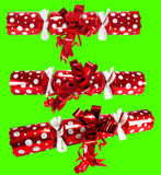 Chroma keyed Christmas crackers. Three red Christmas crackers keyed against green background Stock Photography