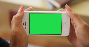Chromakey on smartphone. At home Royalty Free Stock Photography