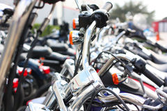 Chrome. Handlebars on a line of parked motorcycles Royalty Free Stock Photo