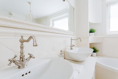 Chrome accents in creamy bathroom Stock Photo